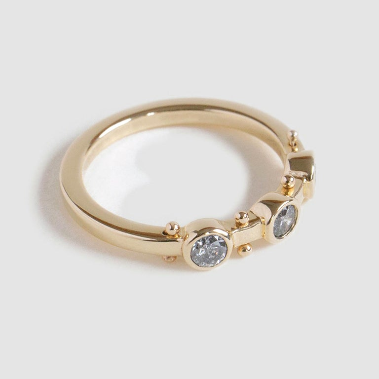 Kaori, meaning fragrance in Japanese. A patchwork of sensory elements, creating a liveliness easier felt than described. The straight profile of this band makes it easy to stack alongside other flat bands.  14K YELLOW GOLD US RING SIZE 7 *Resizing