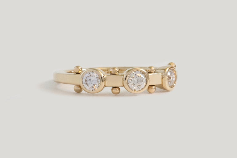 A patchwork of sensory elements, creating a liveliness easier felt than described. Like stepping stones on a path to forever love.  STONES ◘  3x 3mm reclaimed White Diamonds (SI, G-H) ◘  Approx. 0.32 total carat weight  MATERIAL ◘  Bead elements