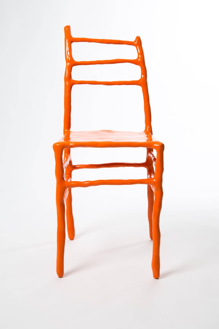 Maarten Baas made this clay chair at the art fair Art Basel in 2007. This chair is one of five orange clay chairs numbered 2/5. He is now one of the most famous Dutch designers. Signed by Maarten Baas with marker. Naam BAAS in metal and year as a