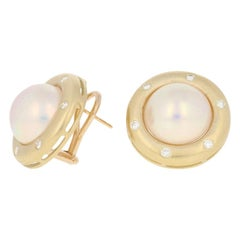 Mabe Pearl and Diamond Earrings, 14 Karat Yellow Gold Pierced Studs