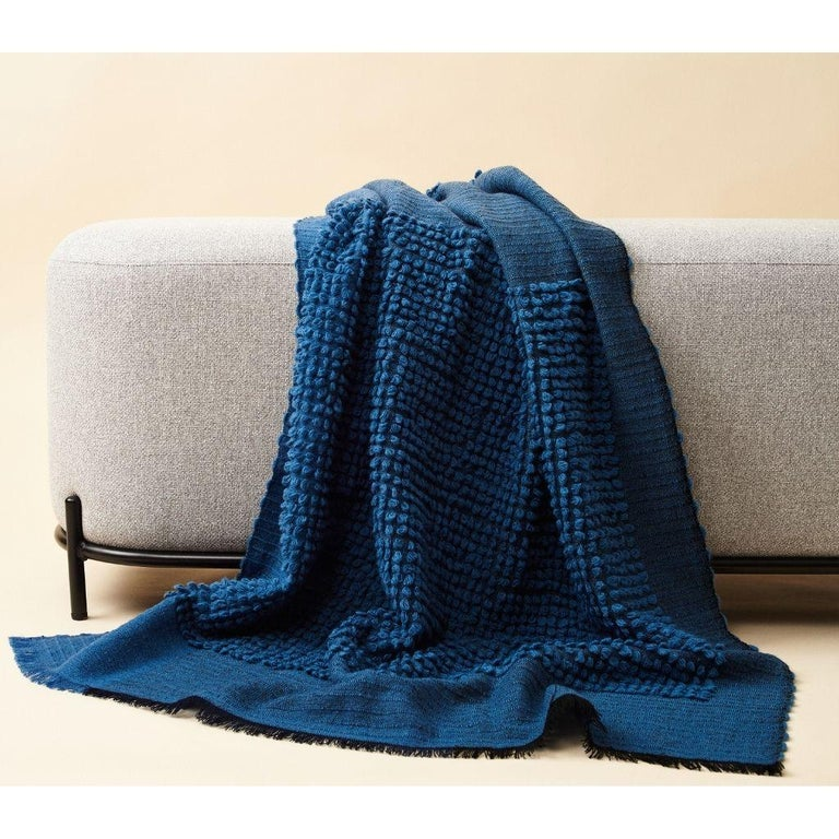 Custom design by Studio Variously, Macaroon midnight throw or blanket is a plush handloom textile ethically woven by master weavers in Nepal and dyed entirely with earth friendly dyes in soft 100% merino yarn.  A sustainable design brand based out