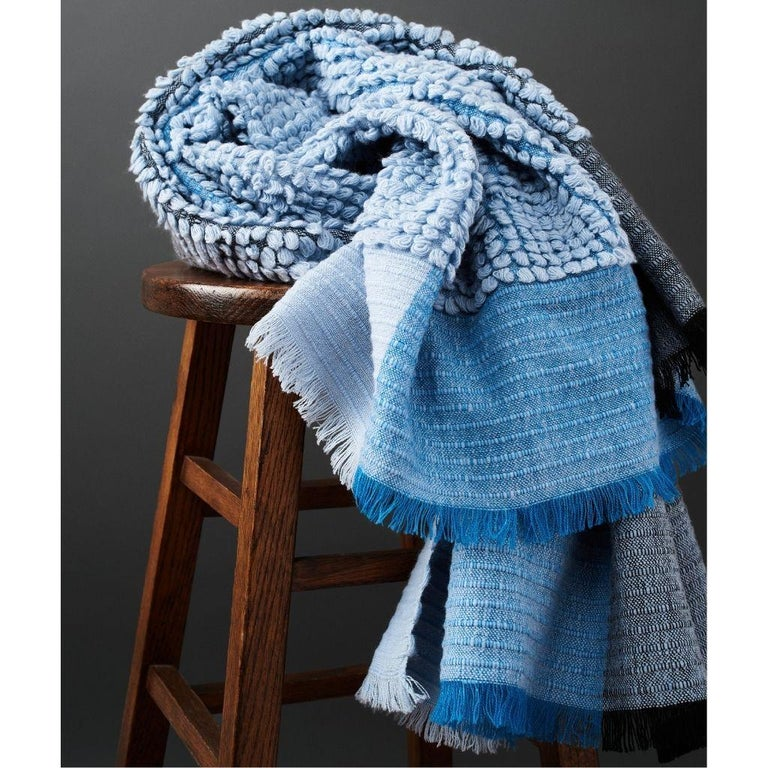 Custom design by Studio Variously, Macaroon sky throw or blanket is a plush handloom textile ethically woven by master weavers in Nepal and dyed entirely with earth friendly dyes in soft 100% merino yarn.  A sustainable design brand based out of