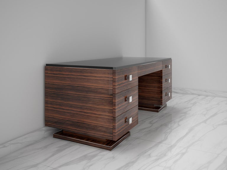 Elegant desk with a wonderful Art Deco design. This beautiful piece of furniture offers a luxurious Macassar veneer, chromed handles and a lacobel glass tabletop. Also available with a leather writing pad.