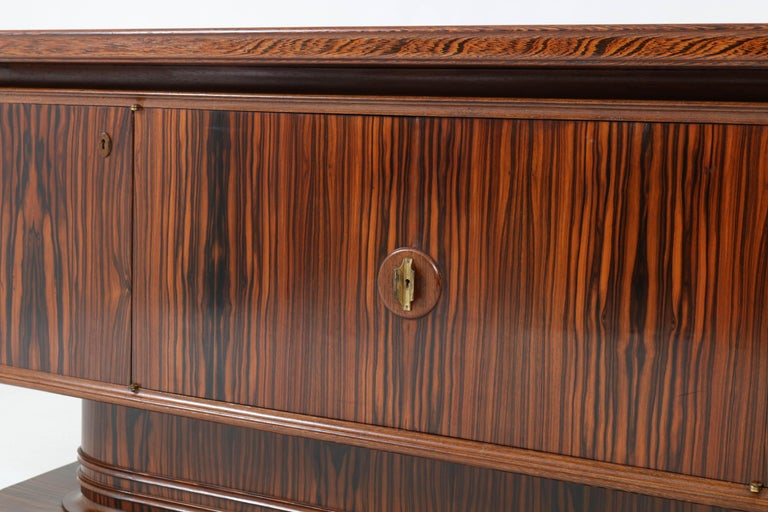Offered by Amsterdam Modernism: Stunning and rare Art Deco sideboard or credenza by Gebroeders Reens Amsterdam. Striking Dutch design from the thirties. This wonderful piece of furniture is veneered with Macassar ebony and has a solid wenge lining