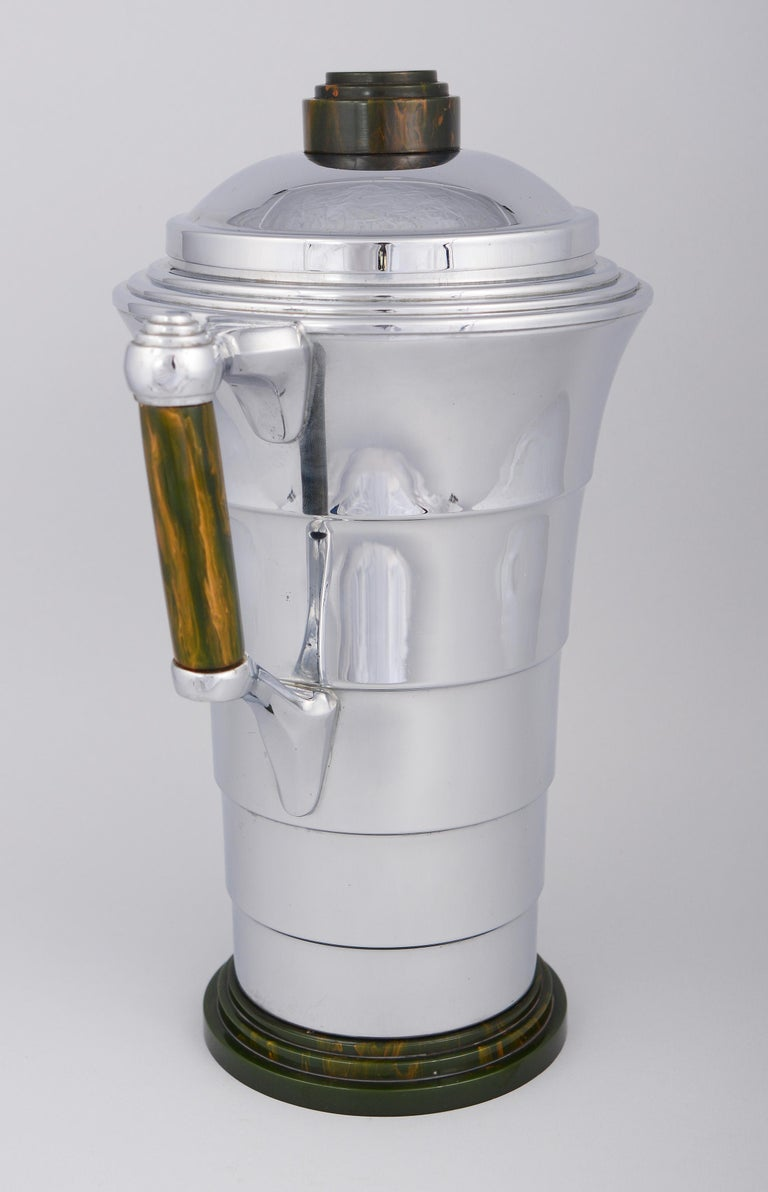 Machine Age chrome cocktail shaker with jade Catalin mounts. This shaker made by Manning Bowman was designed circa 1928. This shaker and two others similar ones that Manning Bowman produced were very expensive in 1928. When the stock market crashed
