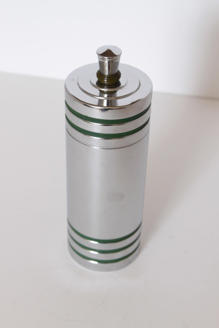 Machine Age Art Deco Chase Gaiety cocktail shaker in rare green Catalin by Howard Reichenbach.  Debuting in 1934, and continuing until at least 1942, the Gaiety shaker (cat # 90034) was undoubtedly one of Chase's most popular items. Truly great