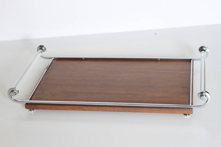 Machine age Art Deco cocktail tray,Manner of James Amster  Rare original drinks or breakfast serving tray, after Amster. Iconic solid glass-rod handles, with chrome rails and feet, walnut base. Base has been satin clear-coated for use.  A
