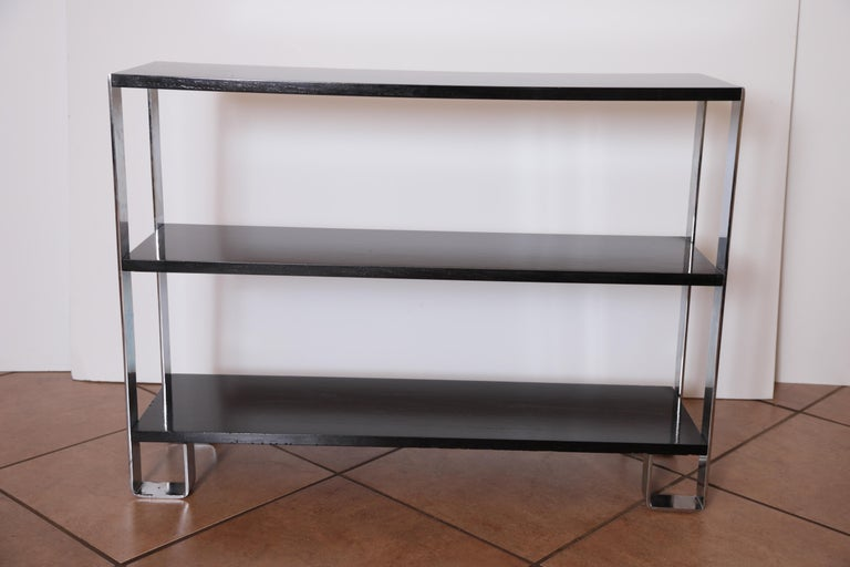 Machine Age Art Deco flat - band chrome / Black lacquer shelf, in the manner of Donald Deskey bookcase entertainment center shelves console sofa table.  A nicely restored example of rectilinear modernist design, in the manner of Deskey and