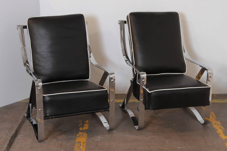 Machine Age Art Deco McKay Craft streamline pair of cantilevered lounge chairs.  PRICE REDUCED  Fully-restored condition. Re-plated polished chrome original steel frames, new black hide leather sling and cushions with white leather piping.  Re-tied