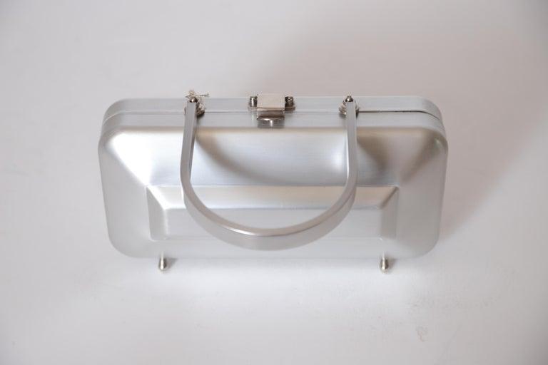 Machine Age Art Deco New Yorker aluminum purse alumilite by Alcoa Pre Kate spade midcentury Mid-Century Modern design  Very rare original unused mint example. Museum quality, with original tag. Alumilite was a proprietary hard-anodized satin