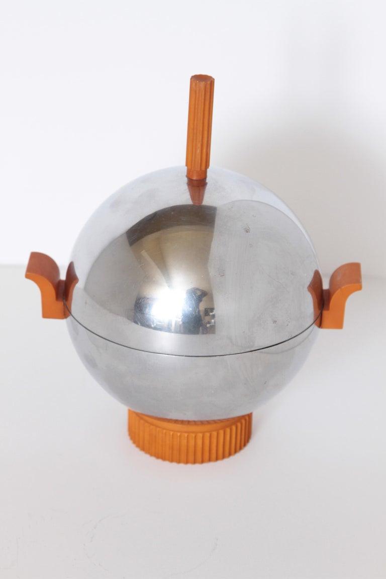 Machine Age Art Deco revere ice bucket / server catalin and chrome  Supreme revere modernist design, in skyscraper / Saturn orb; manner of Lobel, Saarinen, etc.  Attributed to William Archibald Welden.