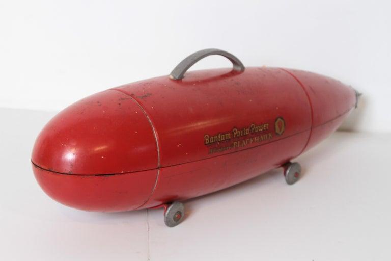 Machine Age Art Deco streamline Blackhawk Porto power tool box, Zeppelin, Torpedo, Bomb.  Fine original four-wheel version, original paint, original decal original screw-off tail piece. The large version, with 4 wheels and tail-piece.
