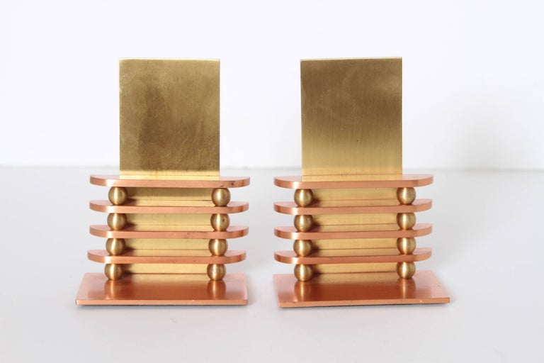 Machine Age Art Deco Walter Von Nessen octaball bookends for Chase, pair  A rare early limited-production Nessen design for Chase, produced only in 1933. Appealing polished copper / polished brass finish.  Catalog # 17041. Much more difficult to