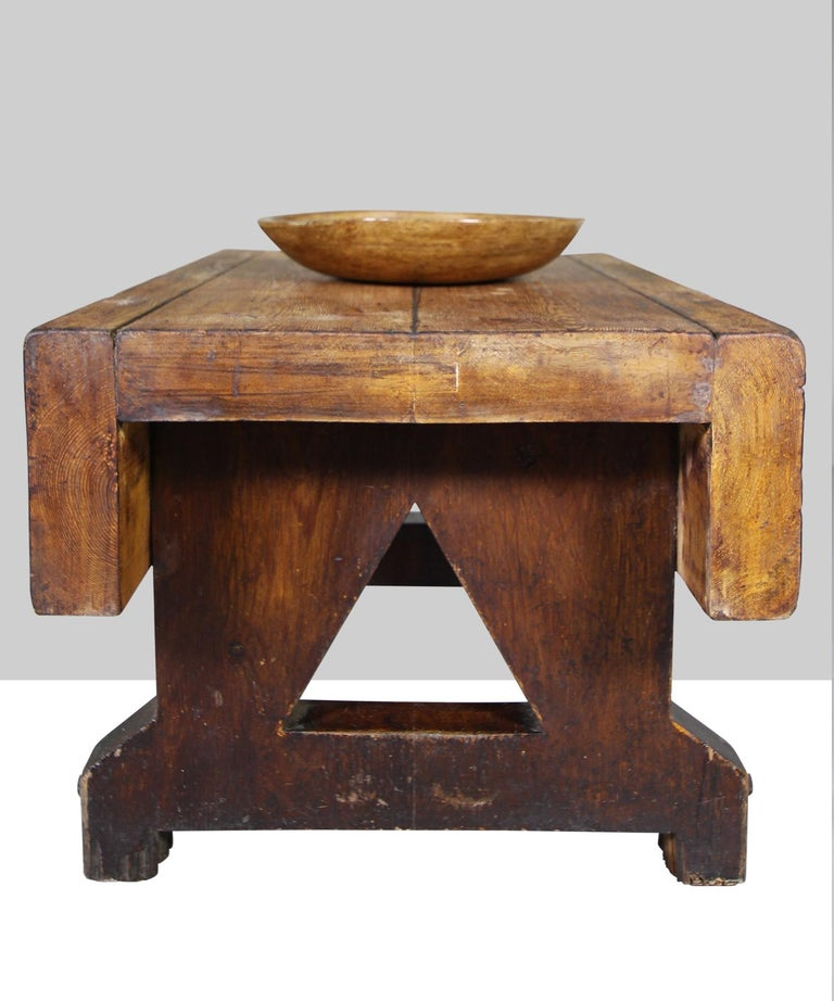 Heavy pine table with original metal bolts and triangular cut outs.