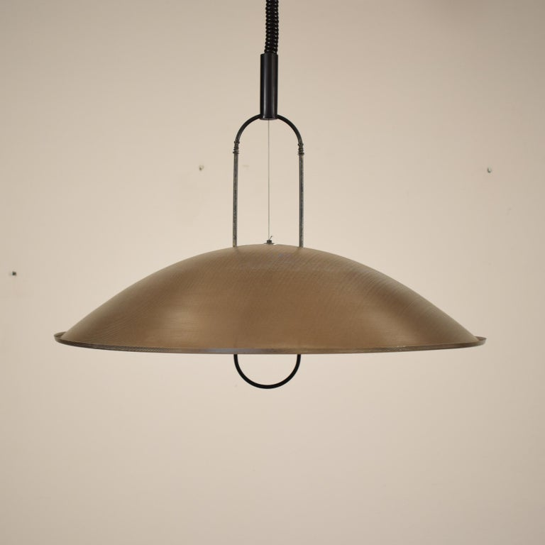 Macumba pendant light by Ernesto Gismondi for Artemide designed in Italy, 1974. Perforated metal and brass. Good original working condition.