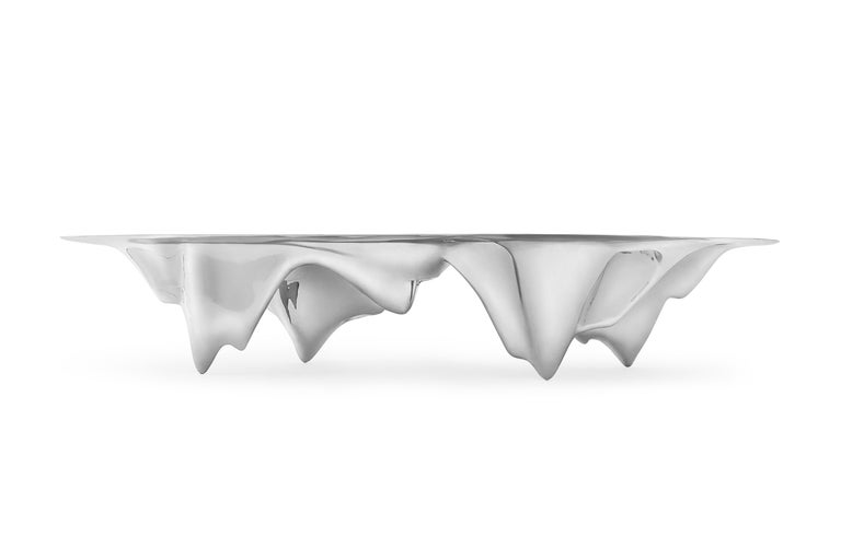 An inverted mountain range the dining table places the peaks of the Martian landscape at the centre of the communal domestic experience of the small colony. This epically large piece is made from CNC'd aluminum, a sophisticated manufacturing process