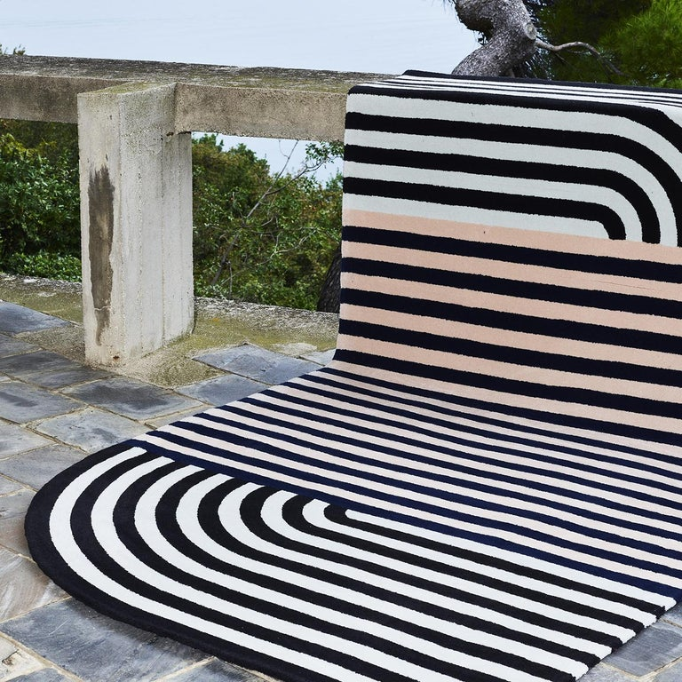 Strong visual allure and a contemporary aesthetic distinguish this stunning rug designed by Alquati+Corso and part of the Roquebrune Collection. Made entirely by hand using virgin wool from New Zealand, the asymmetrical silhouette of this piece is