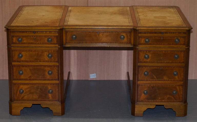 We are delighted to offer for sale this exceptional reverse breakfront twin pedestal partner desk hand made in England by the skilled craftsman at E.G Hudson