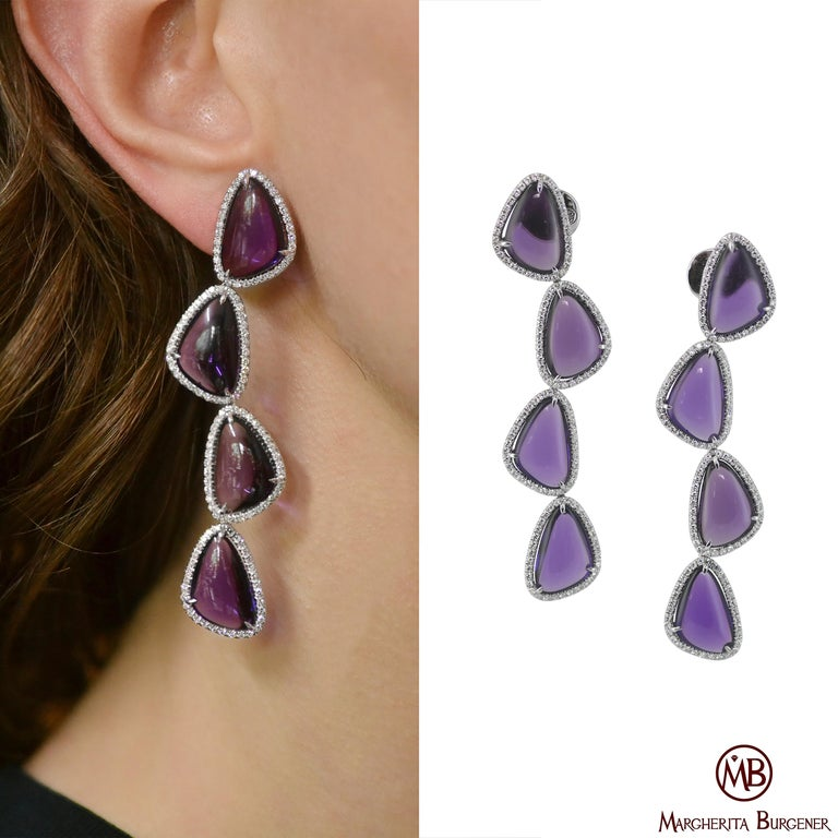 Handcrafted in Margherita Burgener family workshop based in Italy, Valenza, the earrings are a beautiful selection of pebbles, slightly bombé, cabochon cut, surrounded by a line of single cut top quality diamonds. They are extremely brilliant.  They