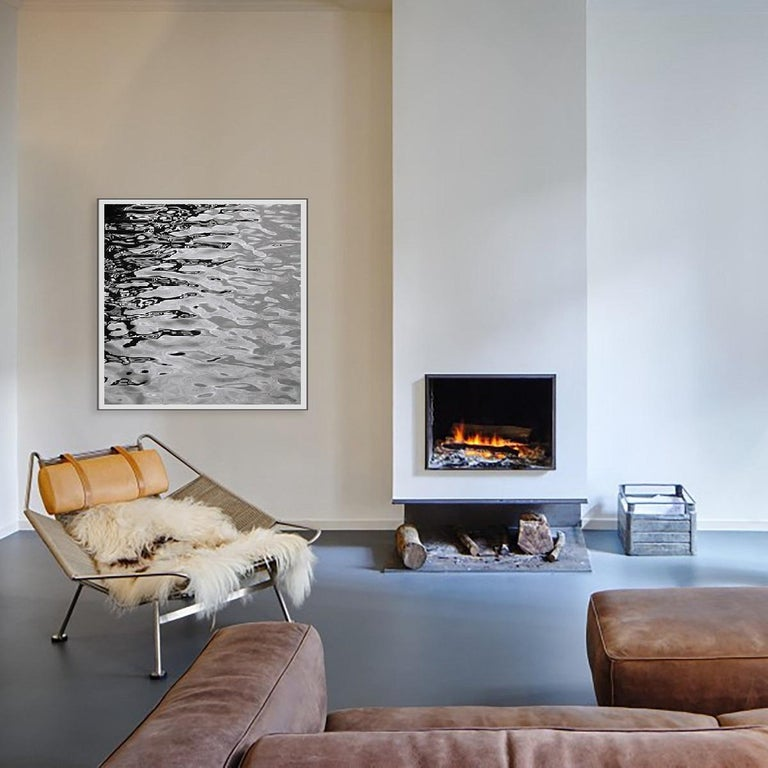 This is a black and white abstract contemporary photography of water and ocean series curated by the gallery in Los Angeles. The portrait of water is conveyed in an abstract and painterly effect. This is a silver gelatin fiber base print handcrafted