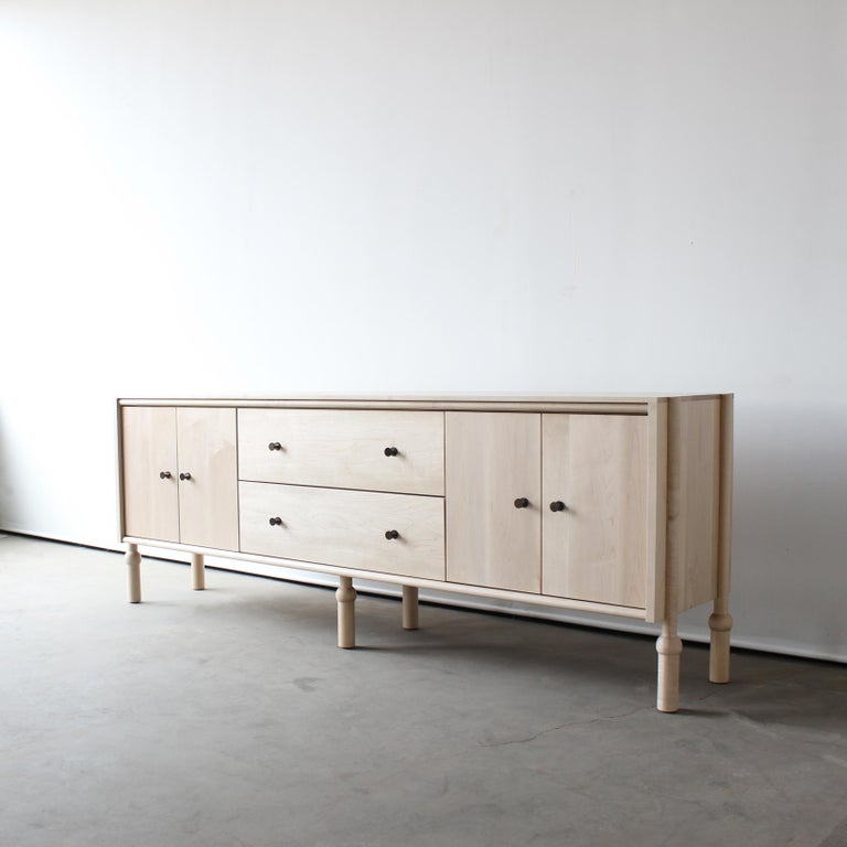 """Solid wood case / hand-turned legs / hand rubbed oil finish / solid brass pulls / premium, full extension, soft close drawer slides / solid wood, dovetailed drawer boxes  Dimensions: 72"""" W x 18"""" D x 30"""" H  Customizations available  Wood:"""