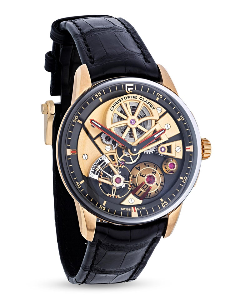 This wristwatch by Christophe Claret is part of the limited edition Maestro collection, and it displays a plethora of novel complications upon a playfully modern face. A large conical date dial topped with a ruby sits at 5 o'clock, creating a