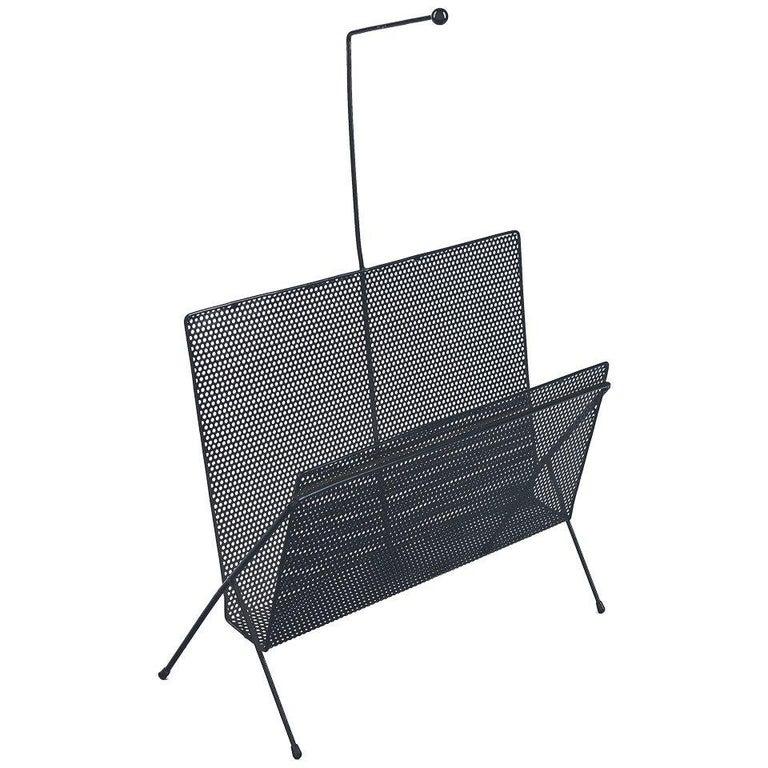 Perforated metal magazine rack.