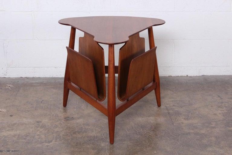 A walnut magazine table model 5313 designed by Edward Wormley for Dunbar.