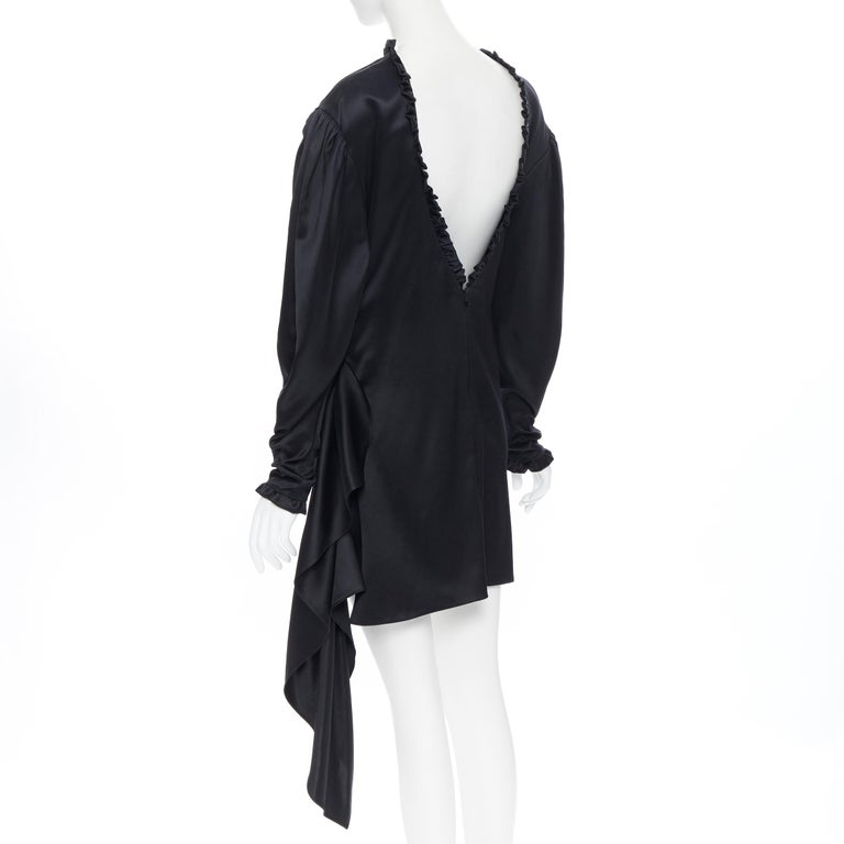 MAGDA BUTRYM black silk wool blend victorian sleeve ruffle open back dress FR36 Brand: Magda Butrym Designer: Magda Butrym Model Name / Style: Cocktail dress Material: Silk, wool Color: Black Pattern: Solid Closure: Zip Extra Detail: Victorian