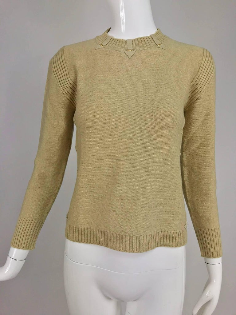 Magdeleine Poncet tan wool knit metal & ultra suede twin set 1970s...Magdeleine Poncet, according to the New York Times of April 25, 1970s manufactured clothing for Lanvin while she had her own elegant collection designed by her daughter Nicole.