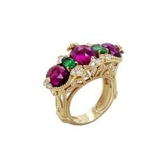 Magenta Garnet and Tsavorite Yellow Gold and Diamond Three-Stone Ring Stambolian
