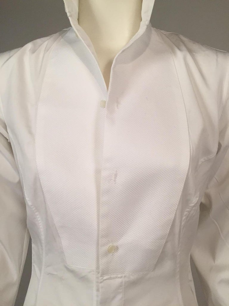 New York City designer Maggie Norris has done a very stylish interpretation of an Edwardian tuxedo shirt for a gentleman, turning the idea into a very chic dress for a 21st century woman. The bib front, collar and cuffs are all white cotton pique