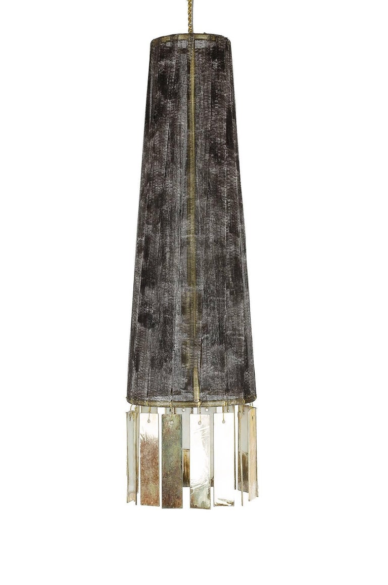 Magic is a hanging lamp entirely handmade and manufactured by hand, in Tuscany, Italy. The lampshade body of this light object is in brass with mat finish. The lampshade is wrapped with hand-painted cotton gauze strips, it is wrapped by hand