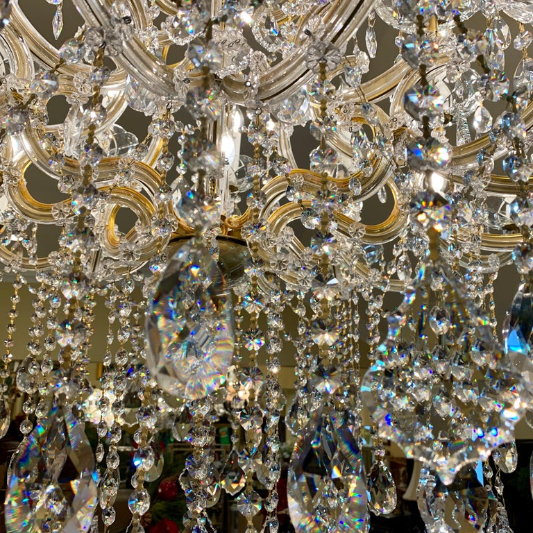Magnificent 25-Light Maria Theresa Swarovski Crystal Olde World Gold Chandelier In Good Condition For Sale In Tustin, CA