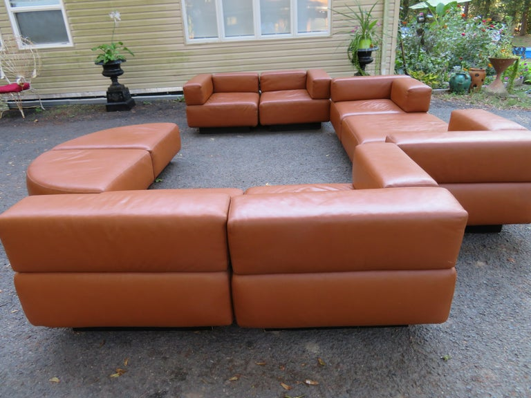Harvey Probber caramel brown leather 'Cubo' sectional sofa nine sections of Harvey Probber designed 'CUBO' modular seating. Set includes six seating units and three ottomans. The sectional is easily positioned into a number of interesting