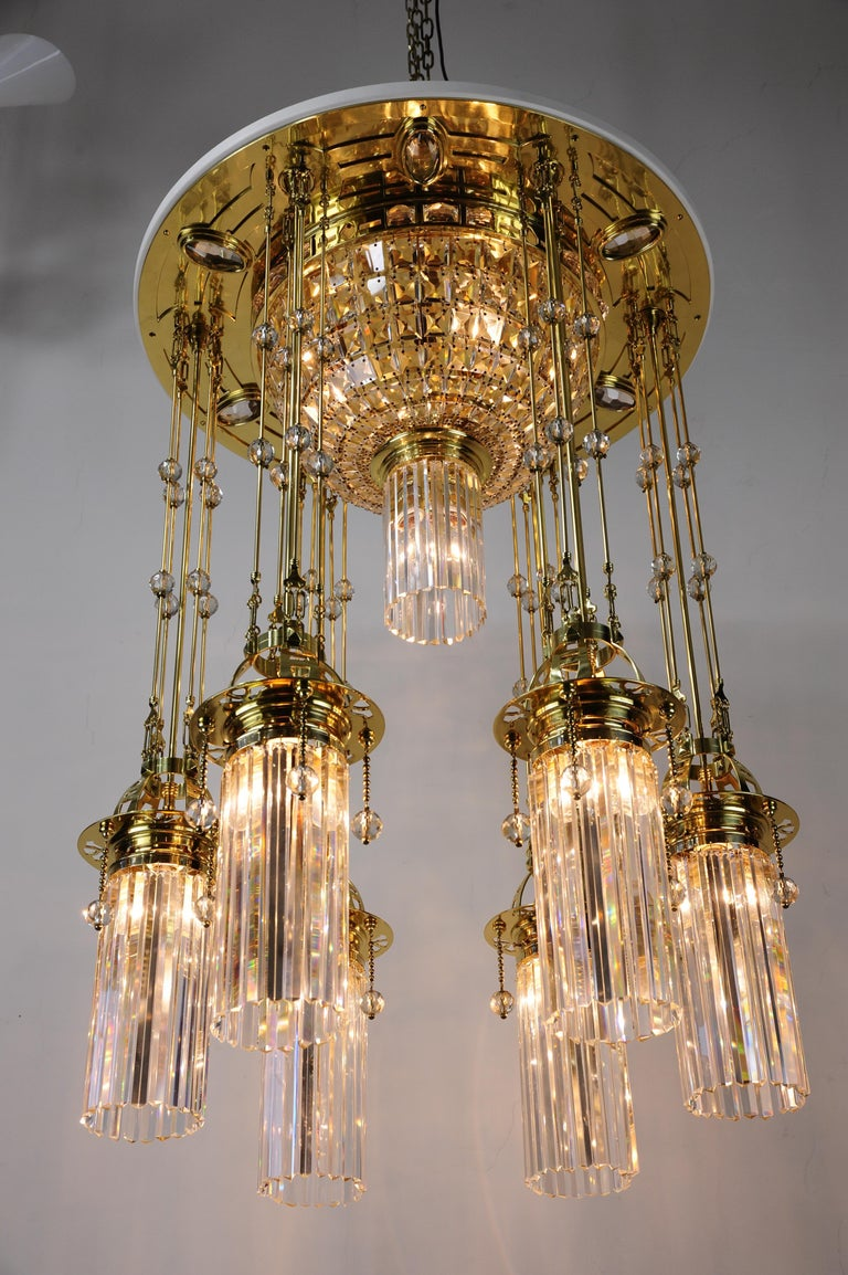 Magnificent and huge Art Deco chandelier Vienna of the 1920s. Polished brass and stove enameled. The crystal parts of the chandelier are original. The chandelier was expertly restored and the crystal was carefully cleaned by hand. The chandelier