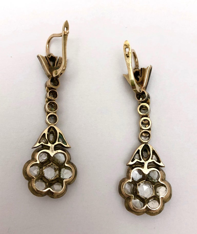 Magnificent antique rose cut diamond drop earrings circa 1890. The earrings have approximately 4.25cts of diamonds. the diamonds are G-H-I color and VS clarity. The mounting is silver top/gold back. The earrings have lever backs. Empire Antiques
