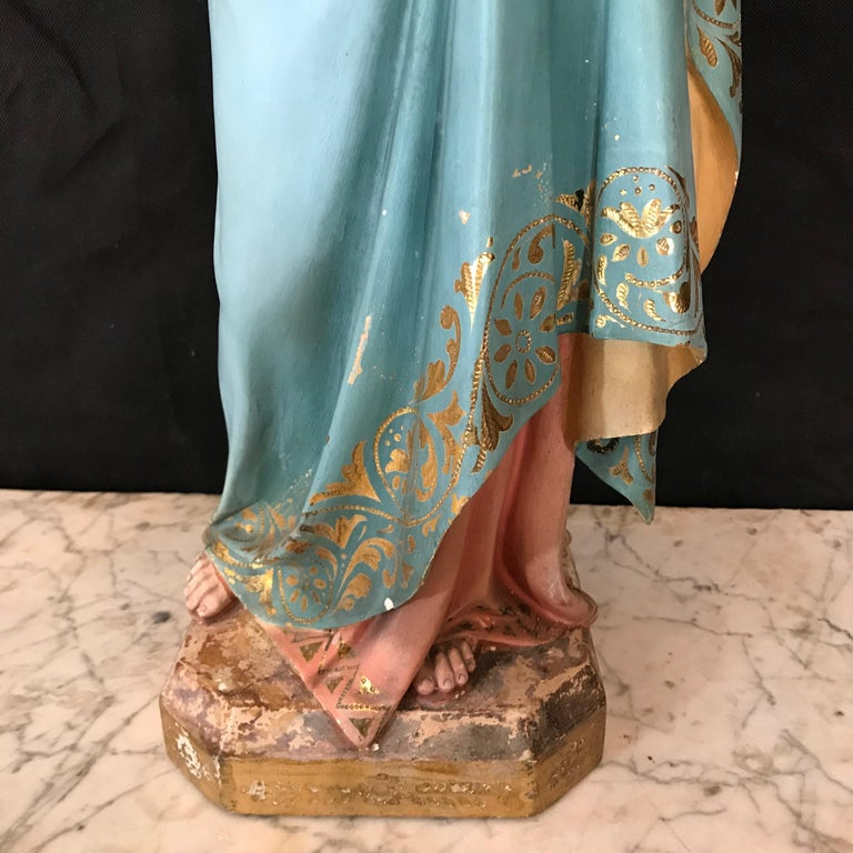 A striking large more than 2 foot tall figure of St. Anne holding Jesus, sourced in Spain and beautifully created with glass eyes on both figures. The subject of Saint Anne and the Virgin and Child was a popular subject in both painting and