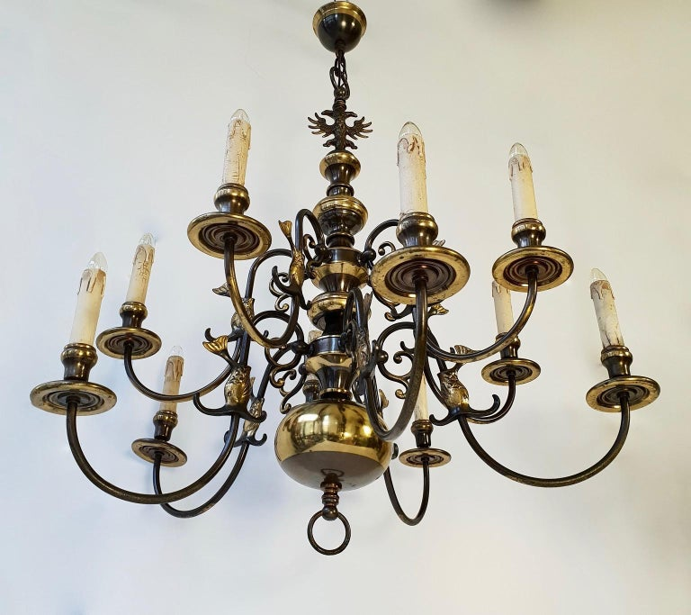 Magnificent antique Flemish chandelier with ten arms. The ten scrolled arms and the top are decorated with eagles and fish, circa 1880. Gorgeous original patina with highly detailed casting of exceptional quality .All original parts. Dimensions: