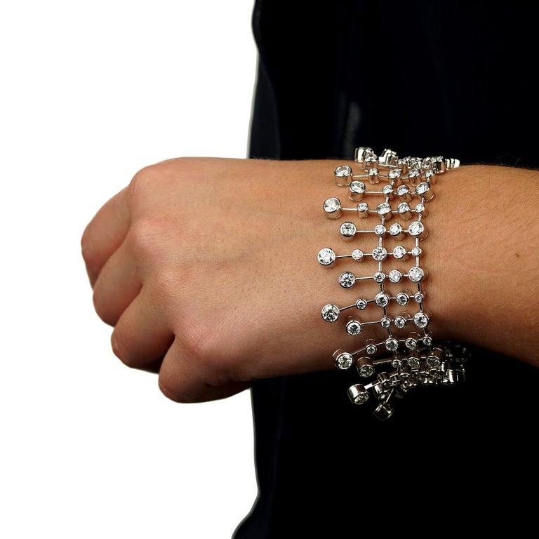 A magnificent Cartier diamond tennis bracelet showcasing 126 of the finest round brilliant cut diamonds set in platinum, the bracelet features a draping and is incredibly comfortable to wear.   The bracelet has a total weight of 20.04 cts in