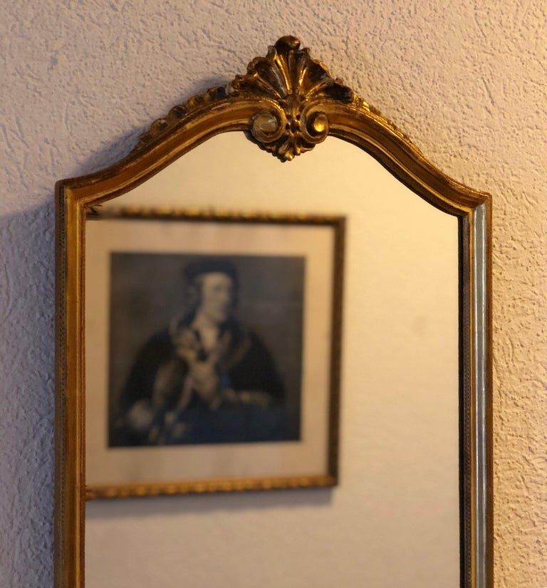An elegant beautiful crystal authentic hand carved giltwood wall mirror, 19th century.