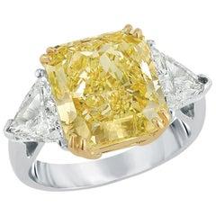 Magnificent Fancy Yellow 7.49 Carat Cushion Cut Diamond Engagement Ring