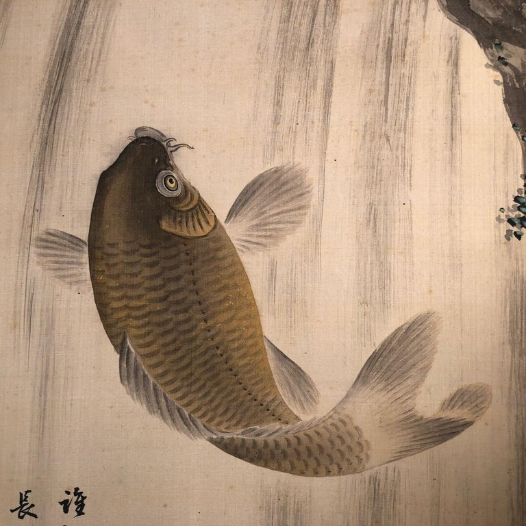 A very fine and bold Japanese antique hand-painted silk scroll of a jumping koi, Meiji period. Hand painting in lively colors with great details, signed.  Inscription:  Every time, Li Bai will cross the river and ride on the blue sky. (Poem by Wang