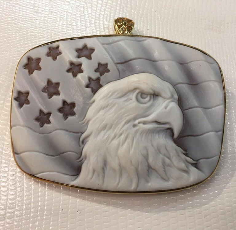 Majestic American Eagle on a backdrop of The Stars and Stripes; Finely hand crafted and signed Cameo set in gilded Sterling Silver mounting; So Striking and versatile, can be worn as a pendant or a brooch! Measuring approx. 2.5 inches x 1.25 inches.