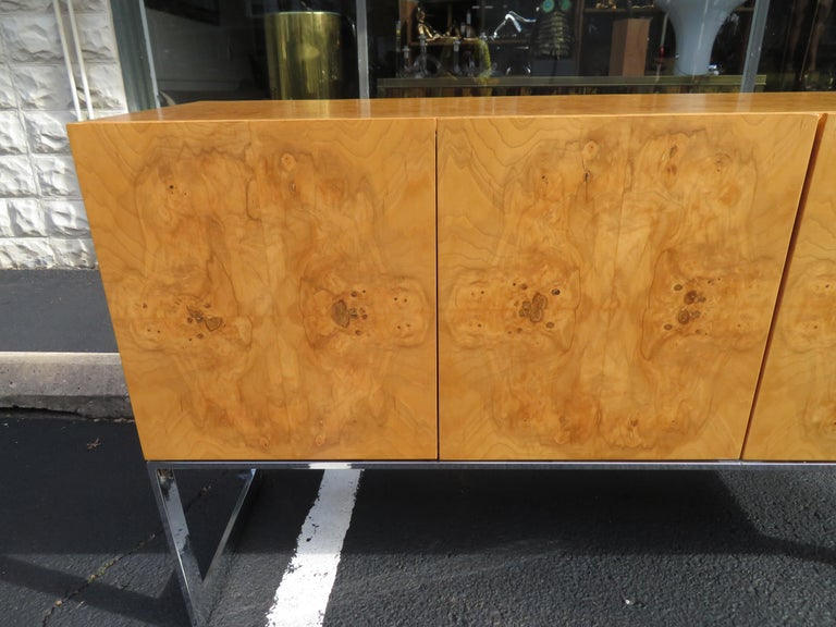 Magnificent Milo Baughman burled olive wood and chrome credenza. This particular piece is in very nice vintage condition, one of the nicest we have had in a long time. It does have the Milo Baughman label in the top drawer and the inside is clean!