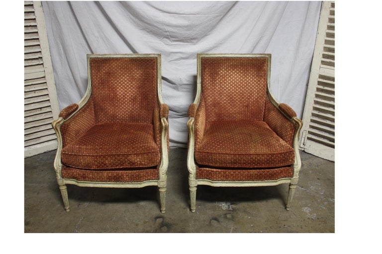 Magnificent pair of 18th century French bergere chairs.