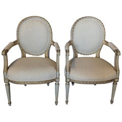 Magnificent Pair of French Painted and Gilded Armchairs
