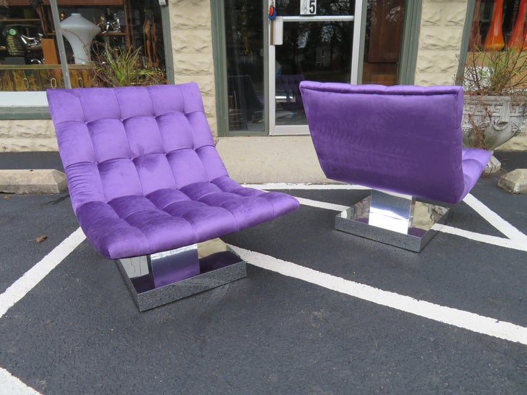 Magnificent pair of totally restored Milo Baughman tufted cube slipper chairs. These chairs have been re-upholstered with a high end lavender velvet and look scrumptious! The chrome bases have been re-chromed and also look amazing! There are no