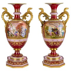 Magnificent Pair of Royal Vienna-Style Gilt Bronze Mounted Porcelain Urns