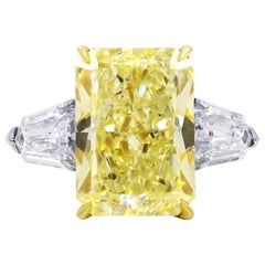 Magnificent Platinum and 18kt Fancy Diamond Ring with Radiant Cut Fancy Yellow